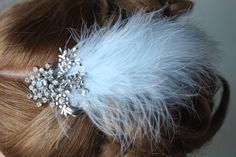Hair brooch, pale blue feather