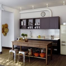 Decorating a Studio Apartment--Kitchen Island doubles as a dining table   homegrowninteriors.com