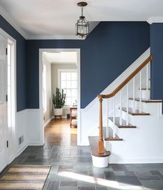 - Stairway Designs & Ideas - A look at my newly painted entryway. Color: Farrow and Ball Stiffkey Blue A look at my newly painted entryway. Color: Farrow and Ball Stiffkey Blue Star Lights On Ceiling, White Hallway, Dark Blue Hallway, Blue Hallway Paint, Stiffkey Blue, Hallway Colours, Entryway Paint Colors, Hallway Colour Schemes, Navy Walls