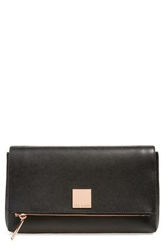 This clutch is seriously so versatile. Could wear it to the the 9-5, or to a night out on the town!