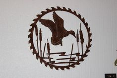 Duck in Reeds on Sawblade Metal Wall Art Country Rustic Hunting Home Decor Duck in Reeds on Sawblade Measures: x (Inches) Hand Made in the USA High Quality Steel Construction Durable Copper Powder Coat Finish Custom Orders Available Contact Us For Details Duck Hunting Decor, Hunting Home Decor, Hunting Rooms, Metal Walls, Metal Wall Art, Metal Work, Wood Wall, Western Decor, Rustic Decor
