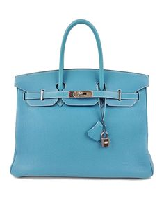 Hermes Birkin 35CM Togo Leather in Blue Jean. This is one of the hottest colors of the 2016 season and it's available right here from former owner Emily Dees Boulden at ShopSwank.com
