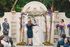 Purple flowers on the chuppah // Found on Modern Jewish Wedding Blog // Photographer: LindseyK Photography