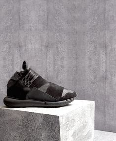Y-3's high-top leather Qasa trainers are updated for the new season in a sleek all-black colourway. They're constructed with contrasting suede panels, elasticated inserts, an internal sock, and a chunky rubber sole.