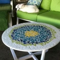 Thrift store table recreated into mosaic art.: