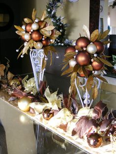 These elegant ornament pomanders are created by grouping matte and shiny glass balls in shades of copper, silver and pearl. Image courtesy of HGTV fan Michelle Aleff.