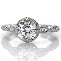 Design 3425 is an elegant combination of a classic halo outline paired with a unique filigree cathedral. A prong set 1.50 carat cushion cut diamond rest at its center with a regal appeal. Bezel set marquise shaped surprise stones add the finishing touch to this extraordinary ring design.