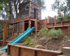 Play house built into the retaining wall design