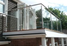 Stainless Steel Posts with Matching Handrail & Glass Infill Panels. Steel Balustrade, Steel Handrail, Glass Balustrade, Glass Railing, Balcony Railing, Deck Railings, Iron Railings, Roof Terrace Design, Glass Balcony