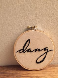 this is a custom made embroidered hoop with a personal design created by randi. the hoop reads dang in a scripted font.   || a b o u t t h e p r o d u c t ||  - 4 wooden hoop - hand-stitched - canvas fabric - black thread   || p e r f e c t f o r ||  - home decor - gift   || c u s t o m i z e ||  - custom orders always available!   || s h o w s o m e l o v e ||  - click on the <3 icon and save as a favorite! - add to cart to purchase your own!   || c o n n e c t ||  - instagram…