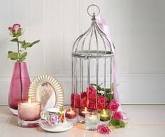 Love the idea of using a vintage bird cage filled with roses and rose petals.  From: https://encrypted-tbn3.gstatic.com/images?q=tbn:ANd9GcQlXVaJ3qgOtbdOakKWwDhLBS6pjAhmAYIM04VyW2UmuWvAaMlr