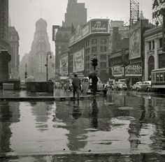TIMES SQUARE, 1943 Photograph by John Vachon | Prints available In this vintage black and white photo, we see the famous Times Square in New York City on a rainy day in March of 1943. The photograph was taken by John Vachon for the Office of War Information