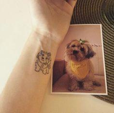 Cartoon pup tattoo