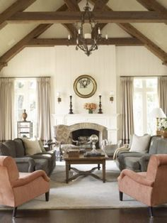 Beamed ceilings + fireplace + chandelier =  perfection