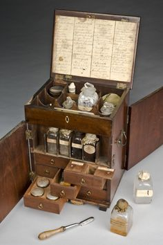The mahogany medicine chest contains boxes, bottles and tubes of medications to treat a number of conditions. The chest includes treatments to purge the body by vomiting (emetics), by sweating (diaphoretics), as well as general purgatives such as rhubarb, jalap and calomel. Other medications include pain relief, such as opium plus astringents and stimulants, including ginger and lavender. The chest contains a handwritten inventory listing the medications.