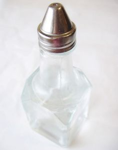 Use white vinegar to brighten your windows. Mix 2 tablespoons of white vinegar with a gallon of water, and dispense into a used spray bottle. Squirt on and wipe away with a clean microfiber cloth (not paper towels, which can cause streaking).