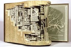 Artist Carves Intricate Worlds in the Pages of Books | Mental Floss