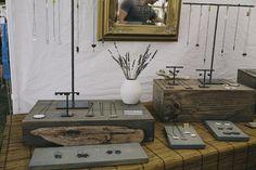 jewelry display - dark wood displays of varied heights, black metal displays, each item is individually priced