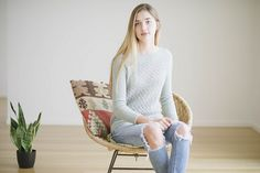 A true transitional piece, delicate April is perfect for the cusp of the seasons—knitted in wool/mohair Piper with an allover lace pattern on the body, this airy pullover designed by Isabell Kraemer features flattering saddle shoulder shaping, ribbing at hem and cuffs, and a faux keyhole at the back neck.