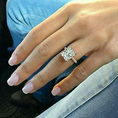 LOVE It, except give me a PEAR shape center stone with double edge halo in white gold.