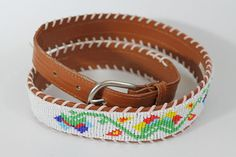 Im old fashioned / I love the moonlight / I love the old fashioned things Try this old fashioned belt with lovely small beads in a festive garden pattern. 36 Long 1 1/2 wide Silver buckle. This item is vintage and should be considered used. There is some wear on the inside of the