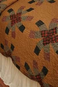 I own this exact quilt...only in the double wedding ring pattern :-)