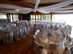 The Pines is a premium function venue in Houghton Bay, Wellington - ideal for weddings, birthdays, celebrations and coorporate events. Wedding Venues, Table Decorations, Furniture, Home Decor, Wedding Reception Venues, Wedding Places, Interior Design, Home Interior Design, Arredamento