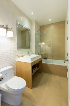 Floor tile same as shower, other tile for wall. Open storage under sink
