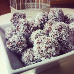 "Raw Cacao Bliss Balls Packed with protein and manage to taste like a dessert, my 3 year old calls them ""chocolate balls"""