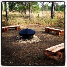 Log benches custom-made for around an outdoor fire pit. Available through Jennifer Taylor Design, Tallahassee, Florida