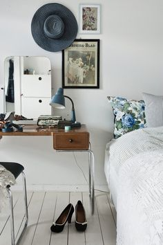 That intense blue, floral pillow slip peaking out form behind stripes, by Camilla Tange Peylecke at WoonBlog