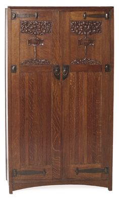 "English Arts & Crafts wardrobe, two paneled doors with deeply carved ""Tree of Life"" design and carved motto on each door ""Salve"" and ""Vale"""