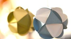 How to Make Paper Ornament Balls! Deceptively easy to construct - we used to make them from vintage Christmas cards! Designed by Robert Mahar for Kin Community