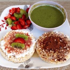 ❝Colorful breakfast for a beautiful day. Brown rice cakes: one with jelly, another one with homemade cocoa almond butter. Green smoothie in a bowl + kiwi & strawberries.❞