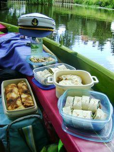 Yummy picnic on a boat with wraps, carrot cake, pancakes and tiramisu