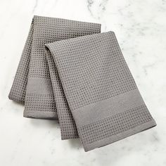 Shop Set of 2 Grey Waffle Weave Dish Towels. Reversible grey dish towels dry dishes in two ways. The waffle weave side provides lint-free drying of glassware, while the super-absorbant terry side dries everything else.