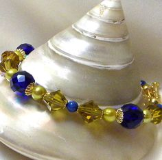 http://www.etsy.com/listing/70981560/czech-crystals-in-cobalt-bicone-crystals  Huge SAle at Golden Rose Crafters Marilyn1545 Everything is on Sale Bracelets 20% OFF FREE key chains with Purchase