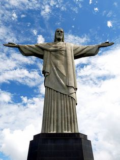 The Cristo Redentor with open arms watching over the city of Rio de Janeiro Image attribution to Artyominc @ Wiki