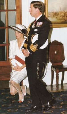 Charles and Diana.. Diana is curtseying to the Queen, who is out of frame 1991
