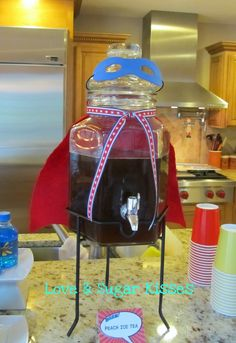 drink dispenser with cape
