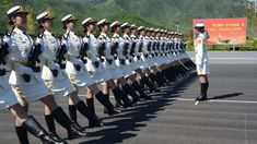 China's female guards of honor will attend the military parade on September 3 for the first time. In this picture, female soldiers of the People's Liberation Army attend a training session at a military base in Beijing on August 22.