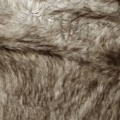 Spoil yourself with this exquisite long hair faux fabric. Fur has alernating 1 1/2'' to 3'' pile, a luxurious hand and a soft subtle sheen just like the real thing! Make gorgeous jackets, coats, wraps, fashion accessories, pillows, throws and more!
