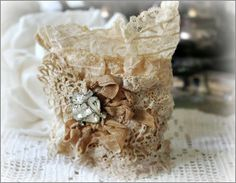 Vintage Lace Cuff - This site is a good inspiration for using vintage lace and rhinestones to make cuff bracelets, pillows, bags, lamp shades and embellished bottles.