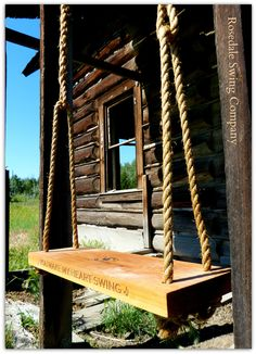 The River swing installed on an abandoned log home on the ranch. from our Blog - Cedar tree and porch swings • Rosedale Swing Company