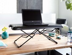 Stay active during your workday with the VARIDESK Soho Height Adjustable Standing Desk.