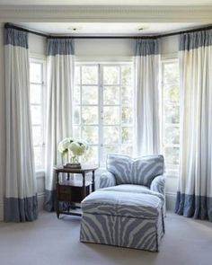 Want a sitting area in master bedroom Love the big comfy chair in the fun fabric. Chambers & Chambers - interesting curtains on the bay window. Bay Window Treatments, Window Coverings, Picture Window Treatments, Window Treatments Living Room, White Curtains, Drapes Curtains, Lengthen Curtains, Curtain Panels, Curtains On Bay Window