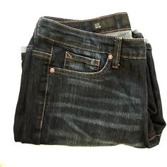 Dark Blue Jean Shorts Dark blue jean shorts with washed streaks in front. Pockets in front and back. Above the knee length. Nine West Shorts Jean Shorts