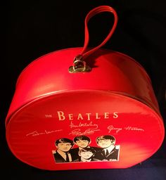 Attention BEATLES fans! This is the uber rare red vinyl Beatles overnight case. The case was licensed by NEMS Enterprises and made by Air Flite Industries in 1964 in two colors, red and black. This measures about 13 inches in diameter and 5 inches deep.It is also called a hatbox. It is thick vinyl covered cardboard with a zippered top that goes completely around. Includes a thick vinyl strap on top. A great find. It won't be around for long. Enjoy it!! #Beatles