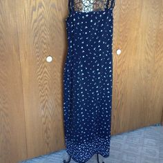 """Long black print drees This long dress has shoulder straps, back zipper, back slit at hem. I lightweight 100% polyester fabric. Length is  just above ankles and I am 5 ft. 9"""" tall. Gently worn. Historia Dresses Maxi"""