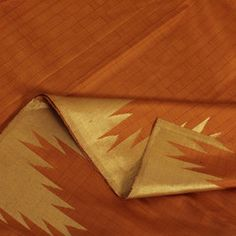 Gorgeous in its simplicity, this Kanjivaram sari will definitely liven up any occasion with its vivid orange and gold hues. The orange body is streaked all over in close-set stripes, resulting in a subtle weave pattern. The pallu is likewise simply adorned, gleaming only in it resplendent zari gold, with sittai pencil at the edges. Meanwhile, oversized gopurams (temple gateways) done in gold embellish the border.Code 180113625